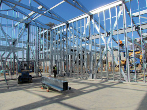 the hss columns support the cold formed steel trusses and are the holdown posts for the cold formed x bracing