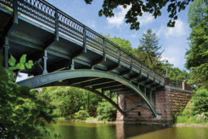 Built in 1900, East Rock Road Bridge is a historic structure within New Haven, Connecticut's scenic East Rock Park. The bridge recently reopened after a $2.1 million rehabilitation.