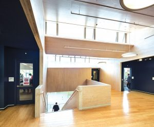 The school's second-floor lobby highlights the use of cross-laminated timber as both a finish and structural material.