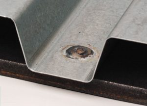Typical arc spot weld deck to structural connection. Courtesy of Steel Deck Institute.