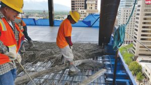 Figure 1. Concrete is placed on an elevated floor metal deck.