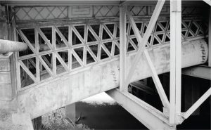 View showing tubular sections and cast iron latticing. Steel work in the right, foreground supports sidewalks added in 1920.