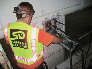 Figure 4. Worker re-tensions a repaired strand.