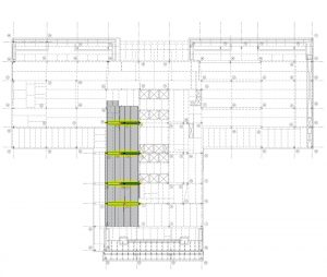 Figure 2. Second-floor framing plan highlighting the columns to be removed in red, the new transfer girders in green, and the existing transfers and column above in black.
