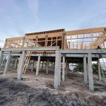 Performance-based design utilizing a moment frame to maximize openings on a new coastal home in Port St. Joe (Gulf County).