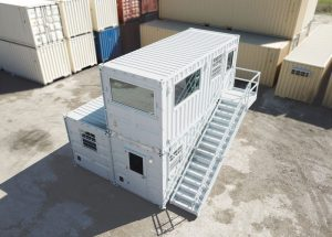 Built for an aggregate company, this Batch Plant Office includes a bathroom and kitchenette on the lower level and an upstairs office to oversee the quarry operations below.