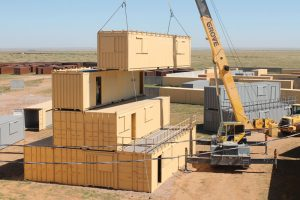 These Military Operations in Urban Terrain (MOUT) training structures were made for Cannon Air Force Base in New Mexico using over 700 shipping containers stacked up to four stories tall.