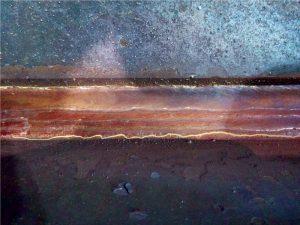 Longitudinal crack at the weld toe.